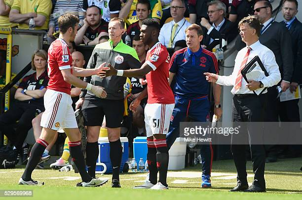 Manchester United manager Louis van Gaal brings on Timothy FosuMensah for Michael Carrick during the Barclays Premier League match between Norwich...