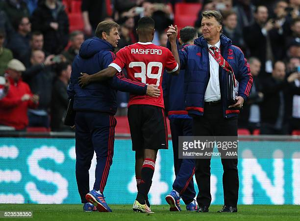 Manchester United Manager Louis van Gaal congratulates Marcus Rashford at the end of the Emirates FA Cup Semi Final match between Everton and...