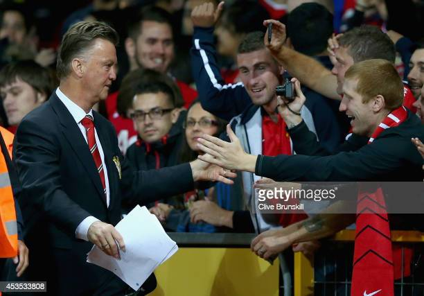 Manchester United manager Louis Van Gaal is congratulated by the fans after winning his home debut in the Pre Season Friendly match between...