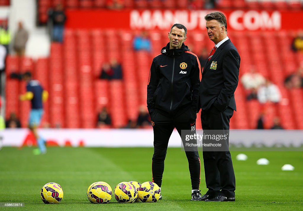 Manchester United Manager Louis van Gaal looks on with his Assistant Ryan Giggs (L) prior to the Barclays Premier League match between Manchester United and Crystal Palace at Old Trafford on November 8, 2014 in Manchester, England.