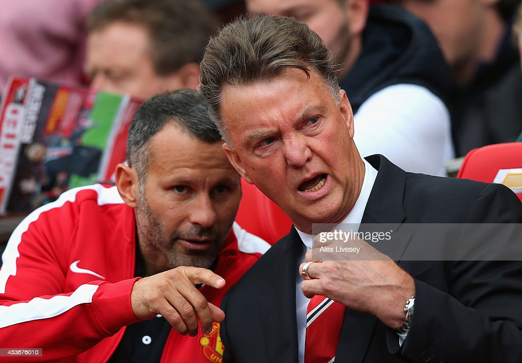 Manchester United Manager Louis van Gaal speaks with Assistant Ryan Giggs (L) prior to the Barclays Premier League match between Manchester United and Swansea City at Old Trafford on August 16, 2014 in Manchester, England.