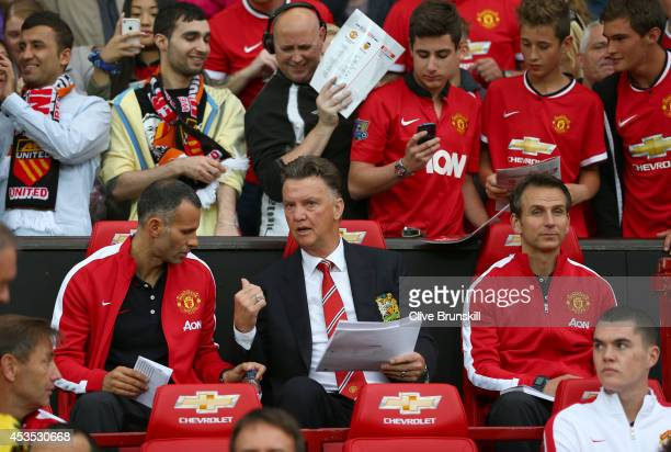 Manchester United manager Louis Van Gaal talks with his coach Ryan Giggs on the bench as he makes his home debut during the Pre Season Friendly match...