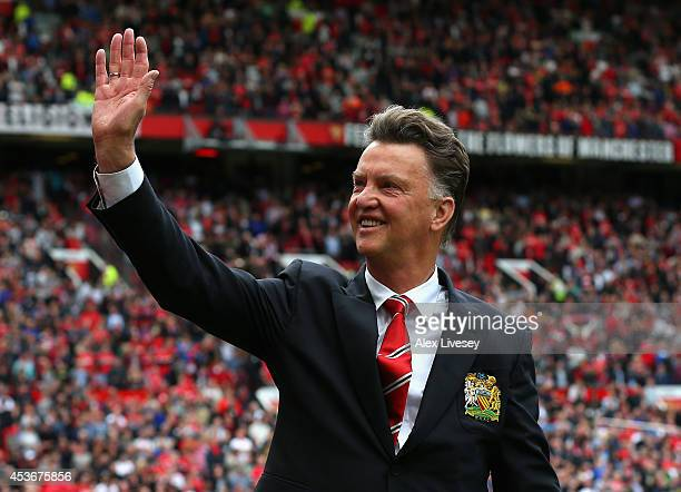 Manchester United Manager Louis van Gaal waves to the crowd prior to the Barclays Premier League match between Manchester United and Swansea City at...