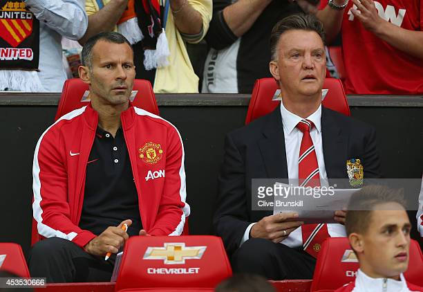 Manchester United manager Louis Van Gaal with his coach Ryan Giggs on the bench as he makes his home debut during the Pre Season Friendly match...