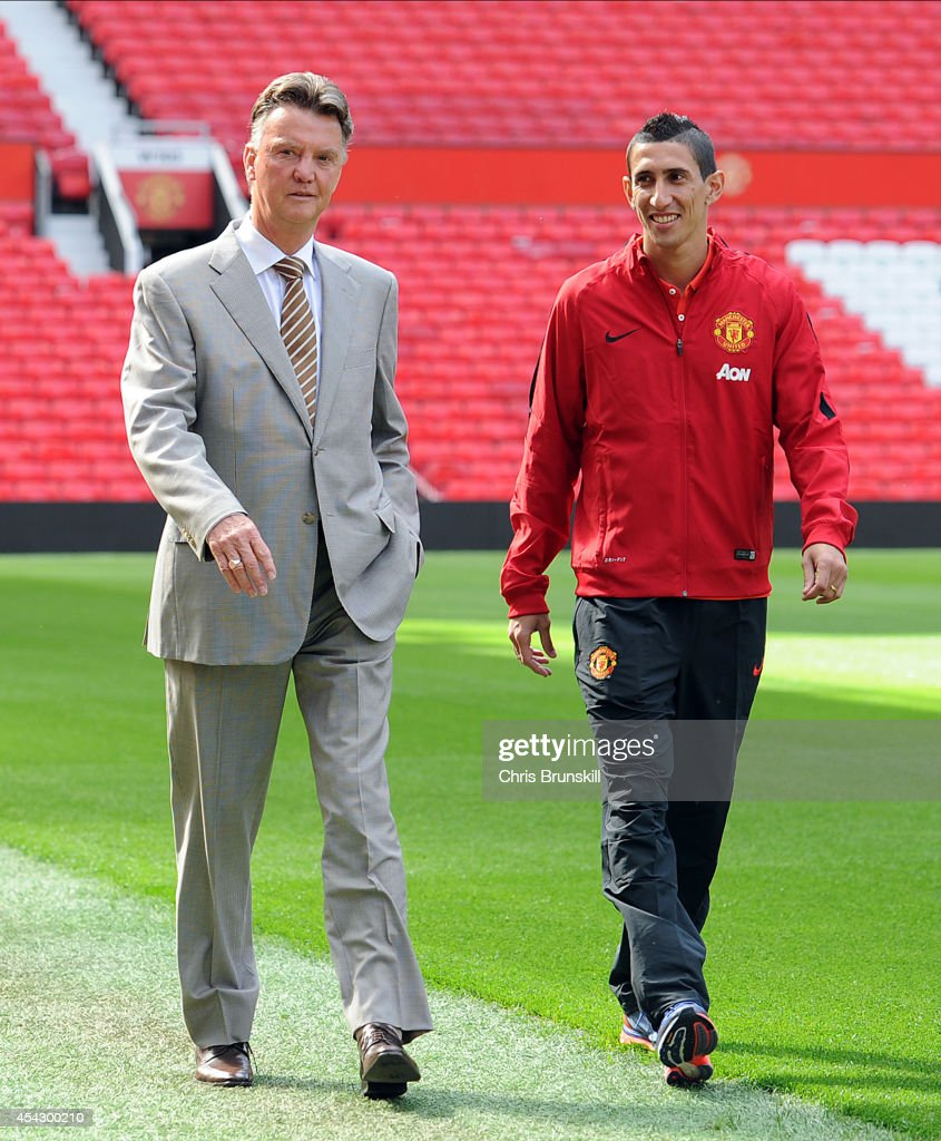 Manchester United manager Louis Van Gaal with new signing Angel Di Maria at Old Trafford on August 28, 2014 in Manchester, England.