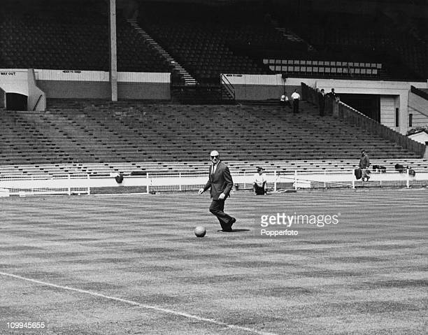 Manchester United manager Matt Busby on the field at Wembley Stadium hours before his team's European Cup final match against Benfica London 29th May...