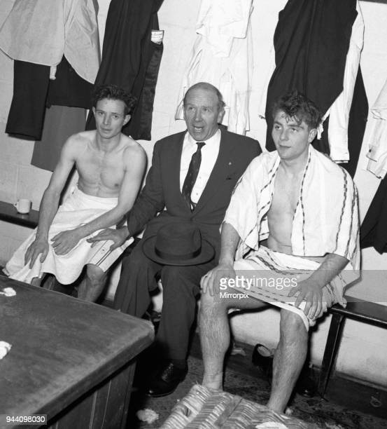 Manchester United manager Matt Busby with two of his players Johnny Berry and Duncan Edwards in the dressing room at Bournemouth after United had...