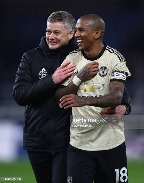 Manchester United Manager Ole Gunnar Solskjaer celebrates with Ashley Young following their sides victory in the Premier League match between Burnley...