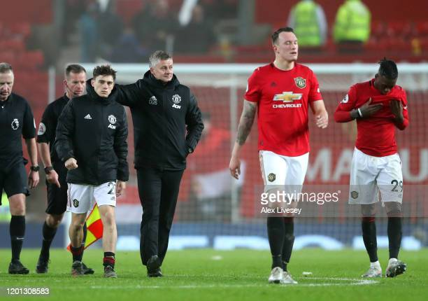 Manchester United Manager, Ole Gunnar Solskjaer consoles Daniel James of Manchester United after defeat in the Premier League match between...