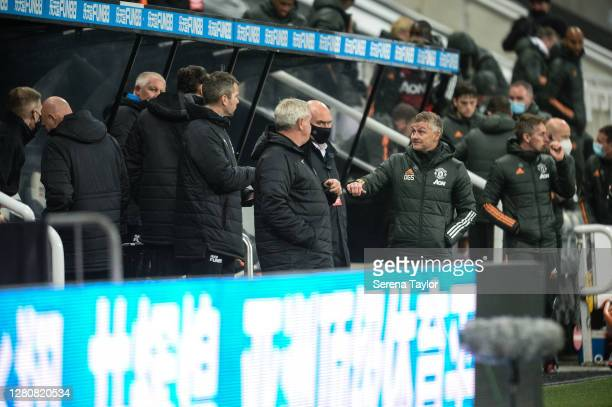 Manchester United Manager Ole Gunnar Solskjaer fist pumps Newcastle United Head Coach Steve Bruce during the Premier League match between Newcastle...