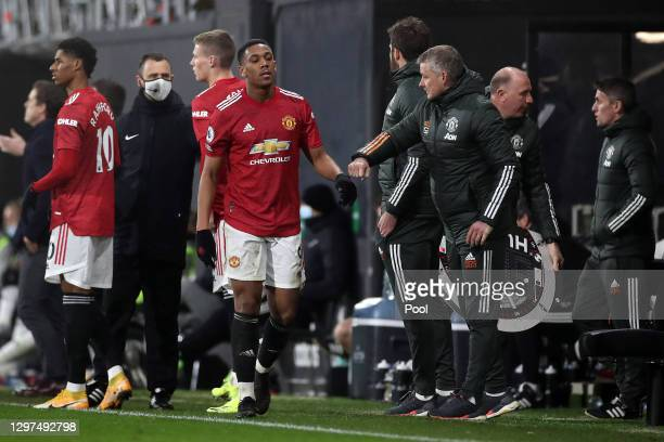 Manchester United Manager, Ole Gunnar Solskjaer greets Anthony Martial of Manchester United off the pitch after he is substituted during the Premier...