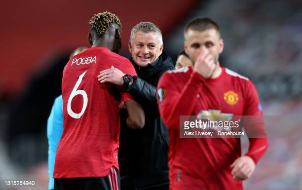 Manchester United Manager Ole Gunnar Solskjaer hugs Paul Pogba of Manchester United after the UEFA Europa League Semi-final First Leg match between...