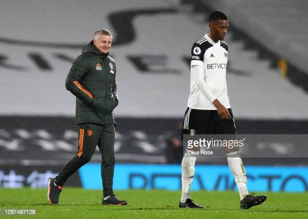 Manchester United Manager, Ole Gunnar Solskjaer reacts following their side's victory as Tosin Adarabioyo of Fulham looks dejected after the Premier...