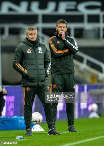 Manchester United Manager Ole Gunnar Solskjaer stands sidelines with ex player and now coach Michael Carrick during the Premier League match between...