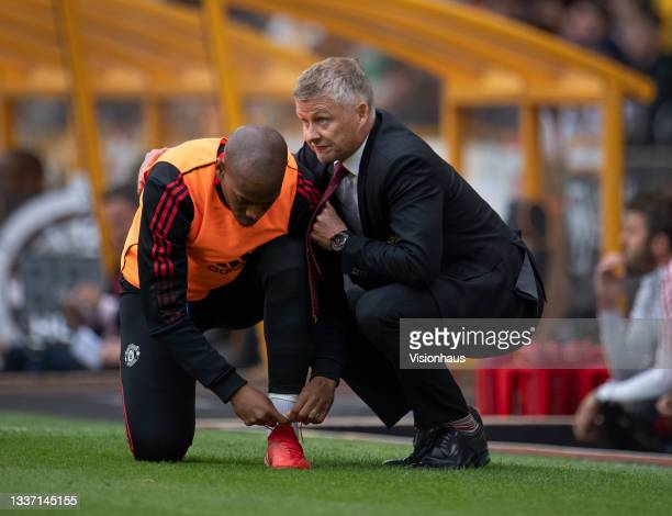 Manchester United manager Ole Gunnar Solskjær talks to substitute Anthony Martial during the Premier League match between Wolverhampton Wanderers and...