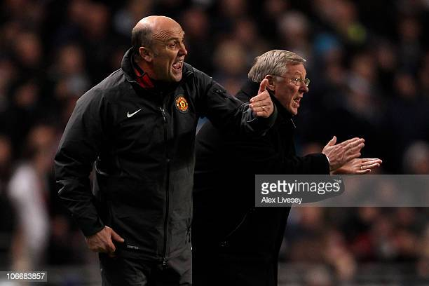 Manchester United Manager Sir Alex Ferguson and Assistant Mike Phelan encourage their players during the Barclays Premier League match between...