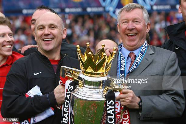 Manchester United Manager Sir Alex Ferguson and Assistant Mike Phelan celebrate with the Barclays Premier League trophy after their side won the...