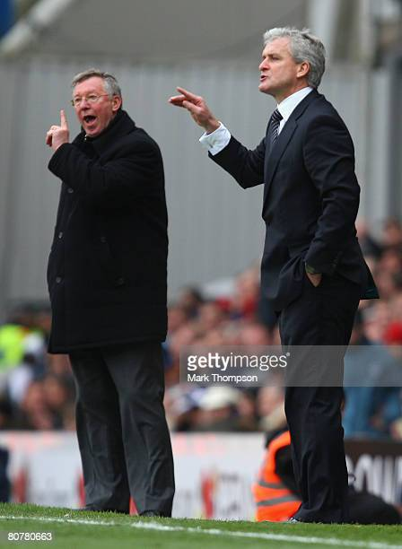Manchester United Manager Sir Alex Ferguson and Blackburn Rovers Manager Mark Hughes shout instructions during the Barclays Premier League match...