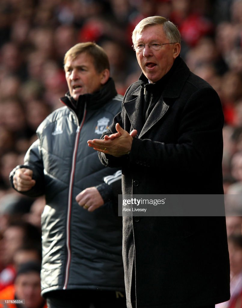 Manchester United Manager Sir Alex Ferguson and Liverpool Manager Kenny Dalglish (L) look on during the FA Cup Fourth Round match between Liverpool and Manchester United at Anfield on January 28, 2012 in Liverpool, England.