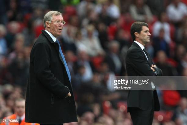 Manchester United Manager Sir Alex Ferguson and Sunderland Manager Roy Keane watch the action during the Barclays Premier League match between...