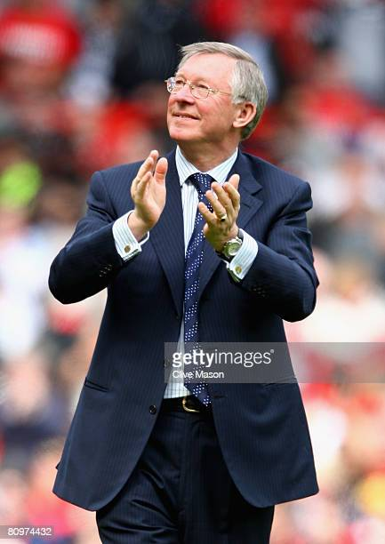 Manchester United Manager Sir Alex Ferguson appaluds the crowd at the end of the Barclays Premier League match between Manchester United and West Ham...