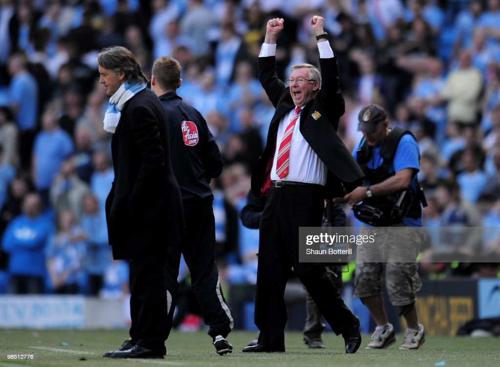 Manchester United Manager Sir Alex Ferguson celebrates as Manchester City Manager Roberto Mancini looks on during the Barclays Premier League match between Manchester City and Manchester United at the City of Manchester Stadium on April 17, 2010 in Manchester, England.