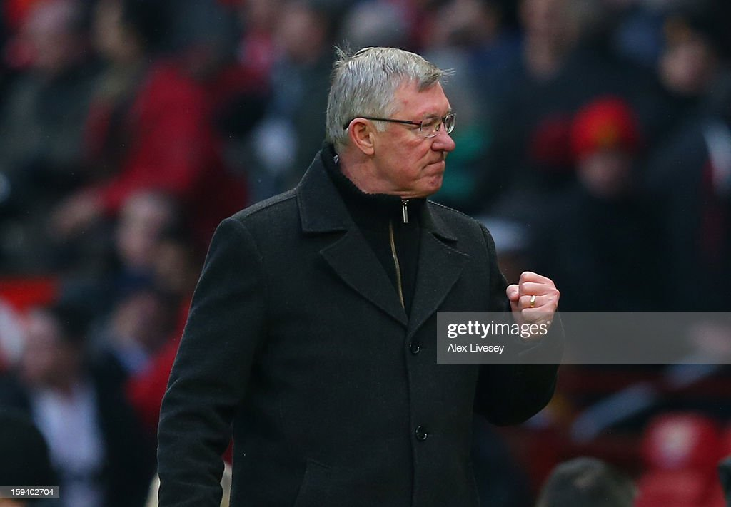 Manchester United Manager Sir Alex Ferguson celebrates at the end of the Barclays Premier League match between Manchester United and Liverpool at Old Trafford on January 13, 2013 in Manchester, England.