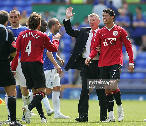 Manchester United Manager Sir Alex Ferguson celebrates with Cristiano Ronaldo and Gabriel Heinze following his team's victory at the end of the...