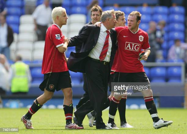 Manchester United Manager Sir Alex Ferguson celebrates with Wayne Rooney and Alan Smith following his team's victory at the end of the Barclays...