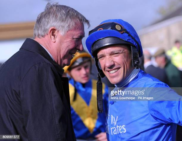 Manchester United manager Sir Alex Ferguson chats to jockey Frankie Dettori in the parade ring ahead of the Mercedes Benz of Doncaster Fleet Maiden...