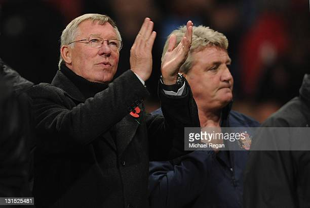 Manchester United manager Sir Alex Ferguson claps the fans as Sunderland manager Steve Bruce looks on during the Barclays Premier League match...