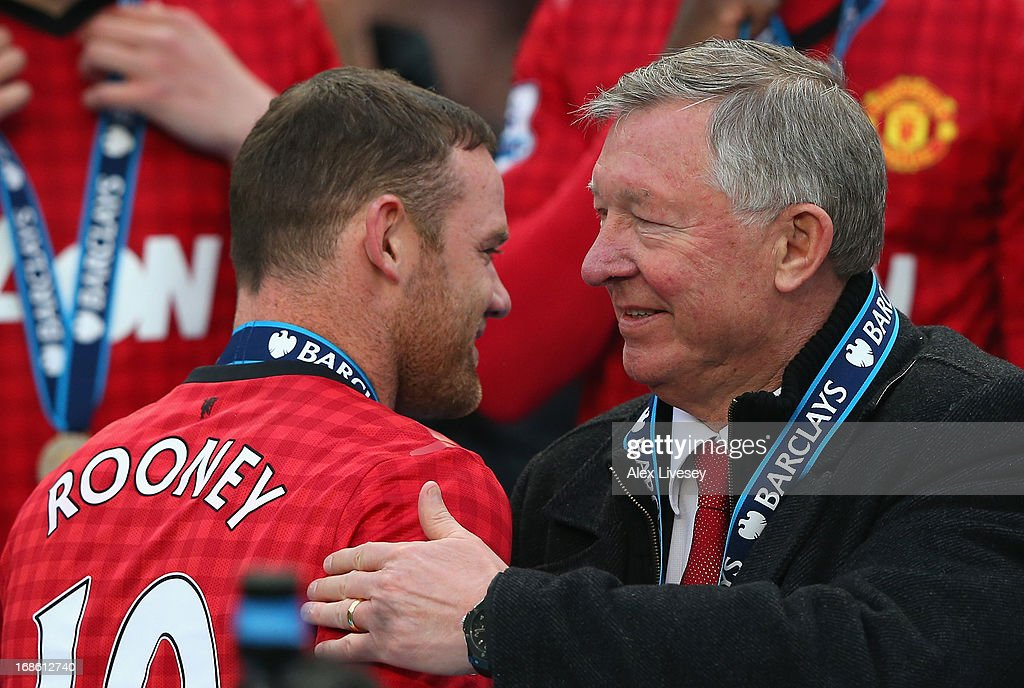 Manchester United Manager Sir Alex Ferguson congratulates Wayne Rooney following the Barclays Premier League match between Manchester United and Swansea City at Old Trafford on May 12, 2013 in Manchester, England.