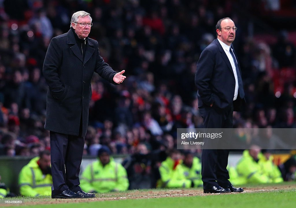 Manchester United Manager Sir Alex Ferguson gestures as Chelsea Interim Manager Rafael Benitez (r) looks on during the FA Cup sponsored by Budweiser Sixth Round match between Manchester United and Chelsea at Old Trafford on March 10, 2013 in Manchester, England.