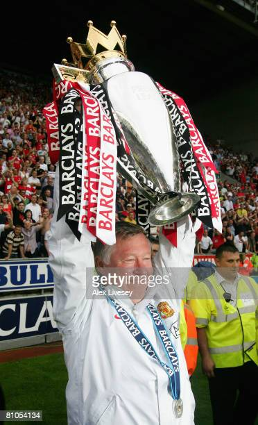 Manchester United Manager Sir Alex Ferguson holds the Barclays Premier League trophy aloft at the end of the Barclays Premier League match between...