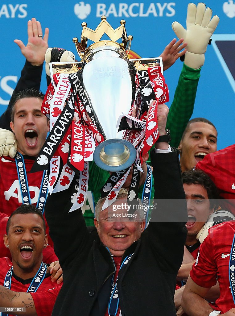 Manchester United Manager Sir Alex Ferguson lifts the Premier League trophy following the Barclays Premier League match between Manchester United and Swansea City at Old Trafford on May 12, 2013 in Manchester, England.