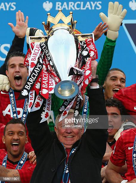 Manchester United Manager Sir Alex Ferguson lifts the Premier League trophy following the Barclays Premier League match between Manchester United and...