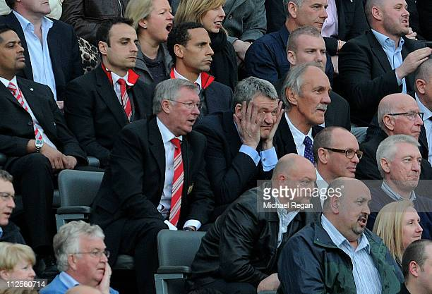 Manchester United Manager Sir Alex Ferguson looks on from the stands with Chief Executive David Gill during the Barclays Premier League match between...