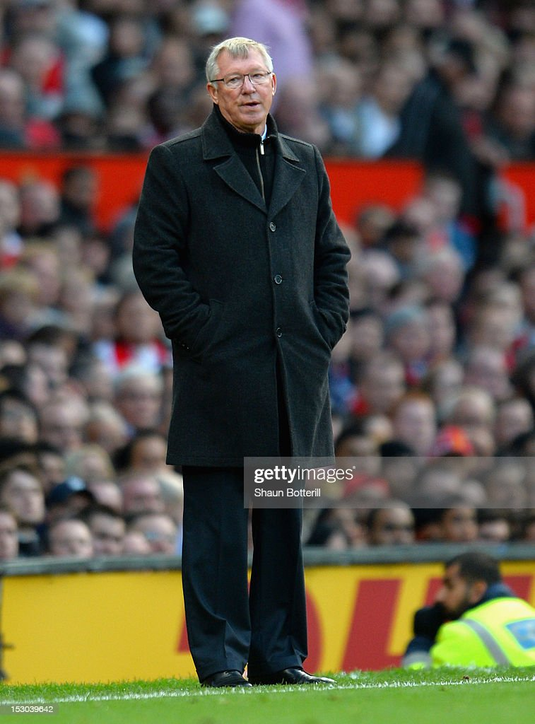 Manchester United manager Sir Alex Ferguson looks thoughtful during the Barclays Premier League match between Manchester United and Tottenham Hotspur at Old Trafford on September 29, 2012 in Manchester, England.