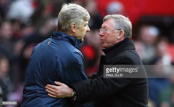 Manchester United manager Sir Alex Ferguson shakes hands with Arsenal manager Arsene Wenger after their English Premier League football match at Old...