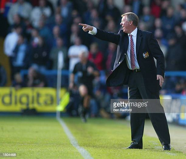 Manchester United manager Sir Alex Ferguson shouts orders to his players during the FA Barclaycard Premiership match between Fulham and Manchester...