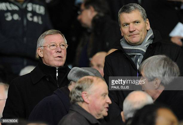 Manchester United manager Sir Alex Ferguson sits with club Chief Executive David Gill following his touch line ban for their English League Cup...
