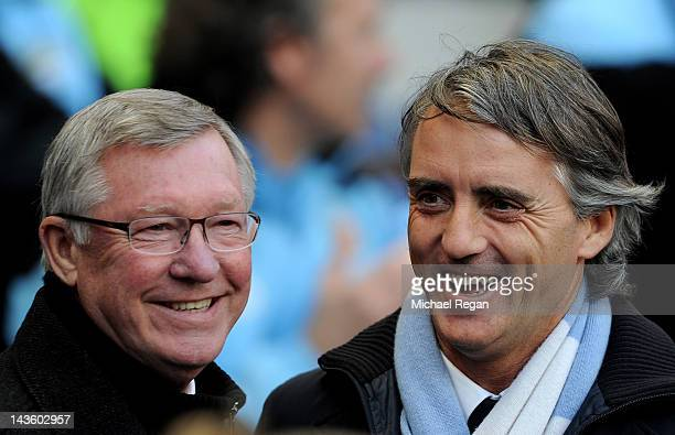Manchester United Manager Sir Alex Ferguson smiles with Manchester City Manager Roberto Mancini prior to the Barclays Premier League match between...