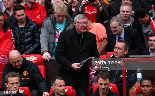 Manchester United Manager Sir Alex Ferguson takes his seat in the dugout for the last time prior to the Barclays Premier League match between...