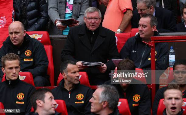 Manchester United Manager Sir Alex Ferguson takes his seat n the dugout for the last time prior to the Barclays Premier League match between...