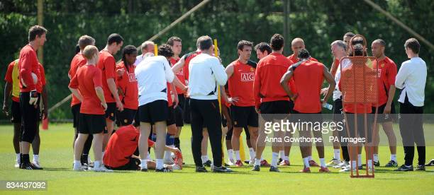 Manchester United manager Sir Alex Ferguson talks to the squad during the Champions League Media Day at Carrington Training Ground Manchester