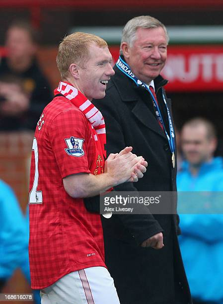 Manchester United Manager Sir Alex Ferguson walks with Paul Scholes following the Barclays Premier League match between Manchester United and Swansea...