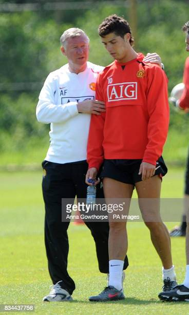 Manchester United manager Sir Alex Ferguson with Cristiano Ronaldo during the Champions League Media Day at Carrington Training Ground Manchester
