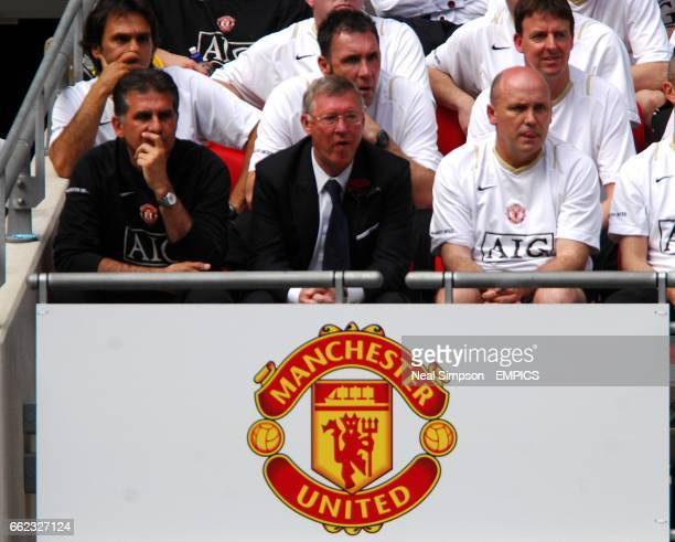 Manchester United manager Sir Alex Ferguson with his assistant Carlos Queiroz and Coach Mike Phelan