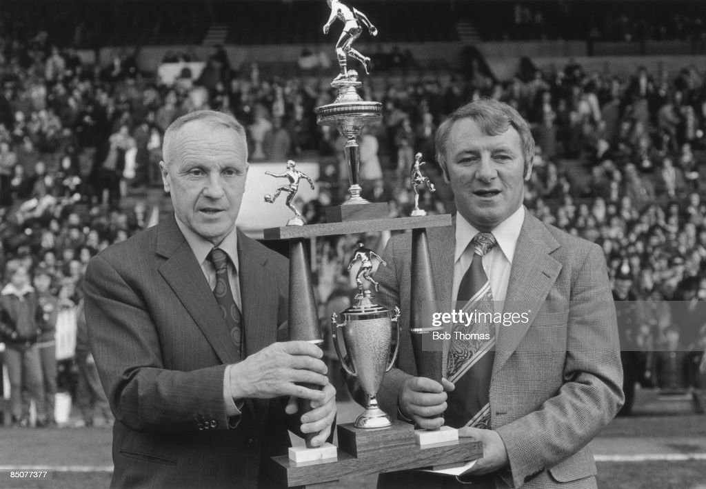 Manchester United manager Tommy Docherty (right) receives an award from former Liverpool manager Bill Shankly (1913 - 1981), 4th May 1976.