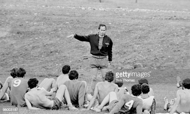 Manchester United manager Wilf McGuinness talking to the players during preseason training at the Cliff in Manchester August 1969